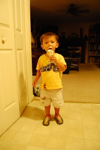 My 2-year-old marching messily through an ice cream cone.