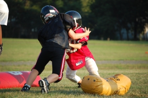 Little kids hitting each other is what anklebiter football is all about.